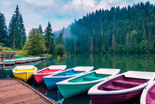 Misty Morning Scene Of Lacu Rosu Lake. Picturesque Summer View Of Harghita County, Romania, Europe. Beauty Of Nature Concept Background.