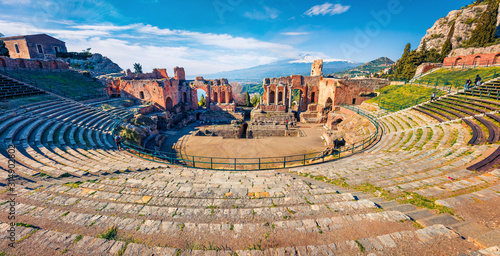 Fotografie, Obraz Panoramic morning view of Taormina town and Etna volcano on background