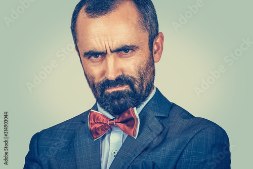 angry man looking accusatory to you camera Wallpaper Mural