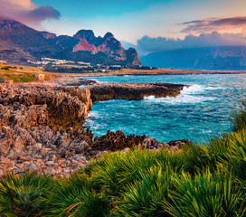 Fototapeta Morze Adorable spring sunrise on Sicily, Isolidda Beach, San Vito cape, Italy, Europe. Dramatic morning seascape of Mediterranean sea. Beauty of nature concept background.