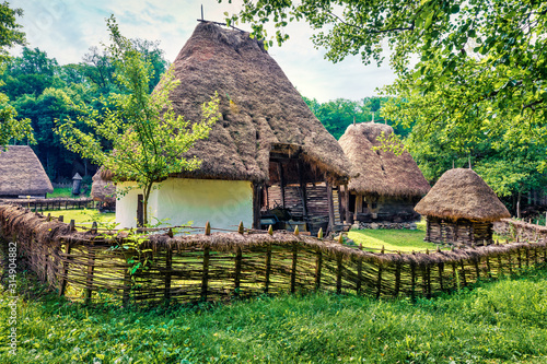 Spectacular summer view of traditional romanian peasant houses Canvas Print