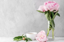 Festive Pink Peony Flowers Bouquet With Coffee Cup On White Table With Copy Space. Still Life. Wedding Background