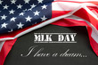 Martin Luther King Day. Flag of USA on black background with text.