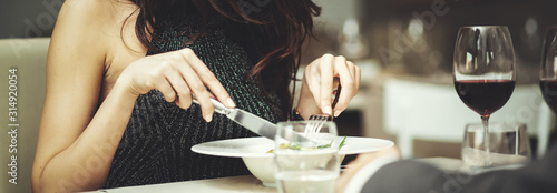 Fototapeta WOman having dinner in a luxury restaurant - detail obraz