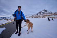 Man And His Dog In The Snow