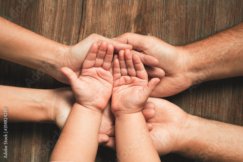 Obraz Three hands of family. Love, togetherness, happiness in family concept. - fototapety do salonu