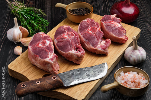Chopped fresh lamb shank steak on cutting board with spice Canvas Print