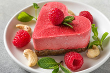 Valentines Day Dessert. Heart Shaped Raw Vegan Red Cake With Raspberries And Mint In A Plate. Healthy Delicious Food