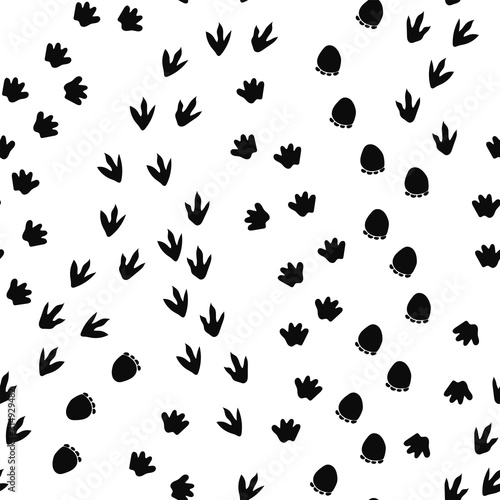 Seamless repeat pattern with different shape black dinosaur foot prints tracks t Canvas Print
