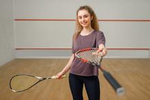 Female Player Gives Squash Rac...
