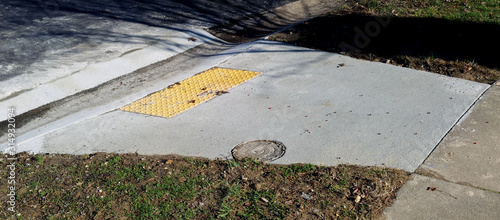 Completed  construction of handicapped accessible curbside ramp. Fotobehang