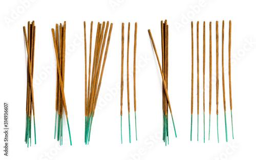 Fototapeta Brown indian incense aroma sticks isolated on white background obraz