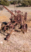 Rusted Vintage Old Plow Trail Road Grader In Autumn Field Sunlight