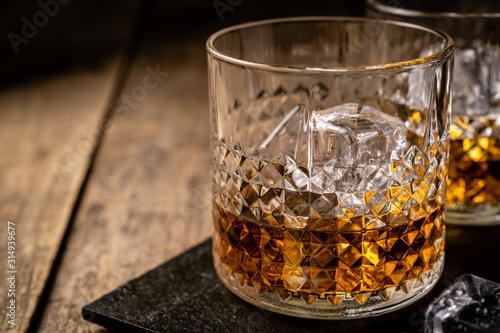 Whiskey in glasses on wood background, copy space, toned Canvas Print