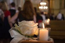 White Rose And Candle In A Chu...
