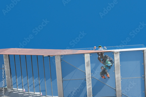 People standing on the observation deck at Birg in the Swiss Alps, photographed from underneath Tablou Canvas