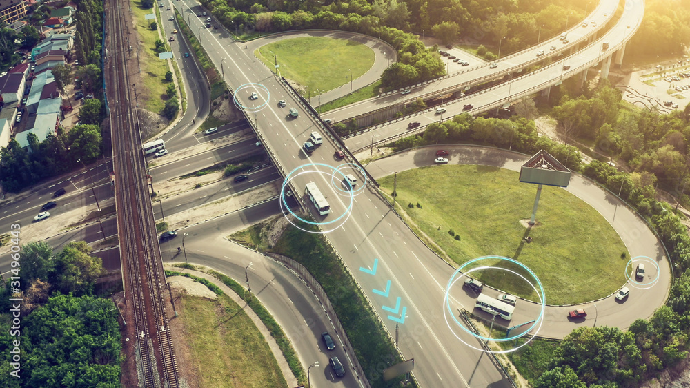 Fototapeta Autonomous Self Driving Cars Concept. Aerial view of cars and buses moving on city intersection and Artificial Intelligence scans road with sensors and control vehicles in traffic. Future