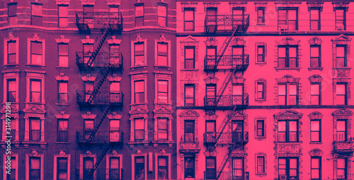 Fototapeta New York City historic apartment building panoramic exterior view in blue and pink color overlay obraz