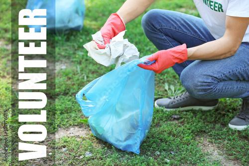 Male volunteer gathering garbage in park Fototapeta