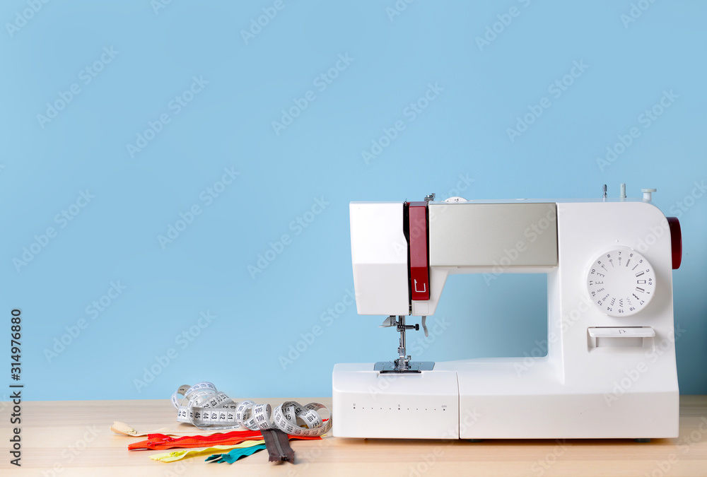 Fototapeta Sewing machine with supplies on table