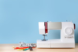 Fototapeta Kawa jest smaczna - Sewing machine with supplies on table