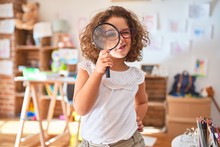 Beautiful Toddler Standing  Wearing Glasses Using Loupe At Kindergarten