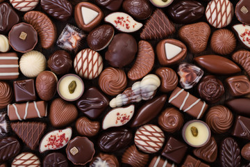 mix chocolate candy, sweet snack, food background.