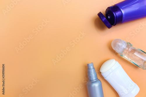 Photo Different deodorants on beige background.