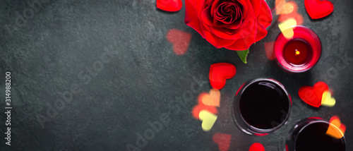 Valentines day concept. Wine glasses, rose and hearts bokeh lights. Banner format - 314988200