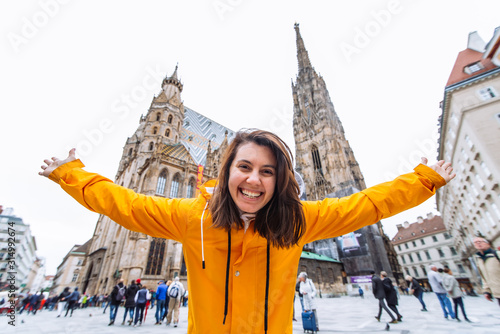 smiling happy woman portrait in front of vienna cathedral church