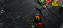 Dark Cooking Banner. Vegetables And Spices On The Kitchen Table. Top View. Free Space For Your Text.