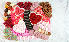 Happy Valentine's Day Flat Lay Overhead Candy And Cookies Dessert Charcuterie Grazing Platter With Negative Copy Space.