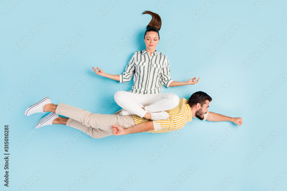 Fototapeta Top view above high angle flat lay flatlay lie concept view of nice inspired spouses flying enjoying hobby leisure isolated on bright shine pastel blue turquoise color background