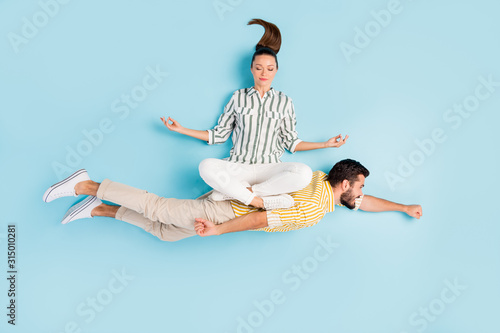 Top view above high angle flat lay flatlay lie concept view of nice inspired spouses flying enjoying hobby leisure isolated on bright shine pastel blue turquoise color background