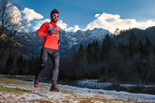Long Distance Runner In The Mountains During A Winter Training