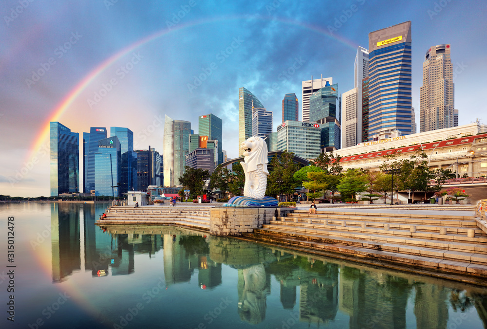 Fototapeta SINGAPORE - OCTOBER 11: Singapore - Merlion fountain with rainbow in front of the Marina Bay Sands hotel at sunrise
