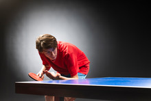 A Boy Playing Ping-pong (table...