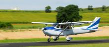 Light Aircraft Landing On Aerodrome Runway