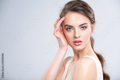 Obraz Portrait of a beautiful young woman with a brown hair. - fototapety do salonu