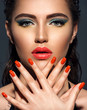 Leinwanddruck Bild - Beautiful woman with bright red lipstick and  nails. Gorgeous girl with blue eye makeup.