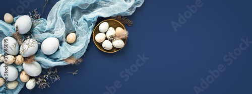 Photo Easter banner with painted eggs and napkin on dark blue backround