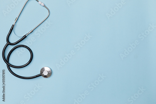 Fotografie, Obraz Creative flatlay of doctor medical equipment blue table with stethoscope, Health