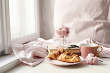 Spring Still Life Scene. Cup Of Coffee, Croissant Pastry, Old Books And Scissors. Vintage Feminine Styled Photo. Floral Composition With Pink Sakura, Cherry Tree Blossoms On White Table Near Window.