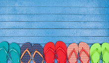 Flip Flops On Wooden Blue Table