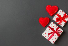 Top View Colorful Valentine Background Made Of Gift Boxes And Red Textile Hearts. Valentine's Day Concept With Copy Space