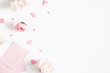 canvas print picture - Valentine's Day background. Pink flowers, envelope, hearts on white background. Valentines day concept. Flat lay, top view, copy space