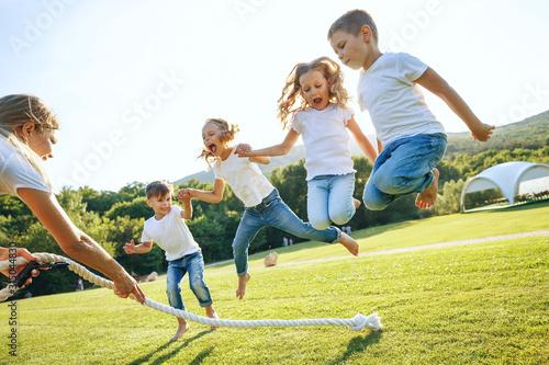 Foto Children play in nature.