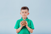 Boy With Coconut In Hand. Isol...
