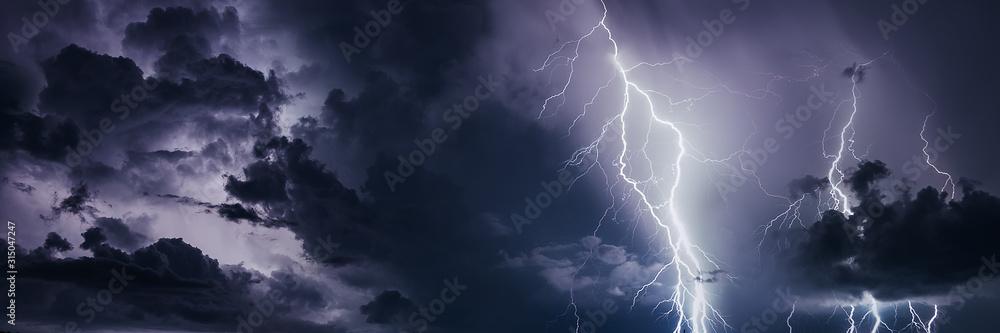 Fototapeta Thunderstorm with lightning bolts, banner image.