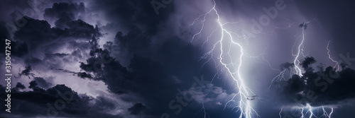 Fotografía Thunderstorm with lightning bolts, banner image.